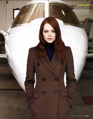 emma stone looking hot in a brown coat