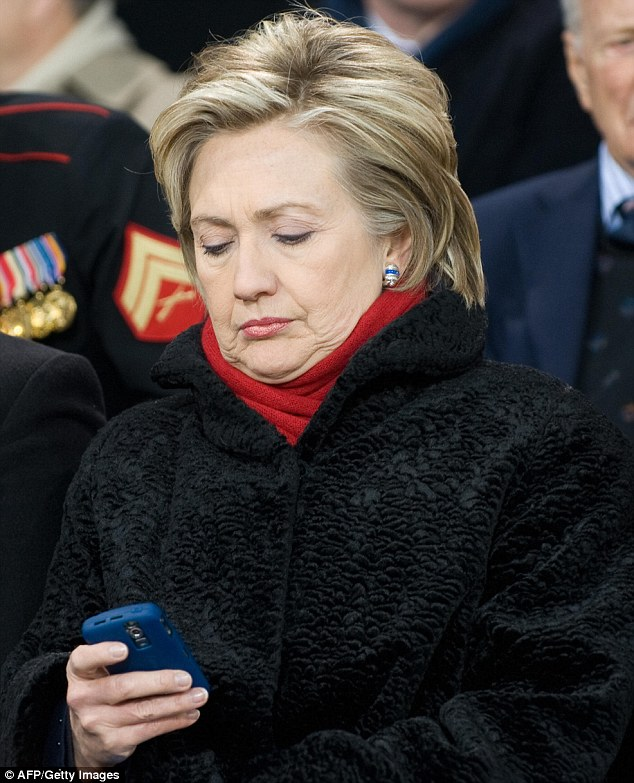 Hillary Clinton checking her email Hillary Clinton checking her email