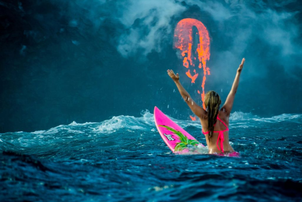 Alison Teal first woman to surf around an erupting volcano by perrin ja