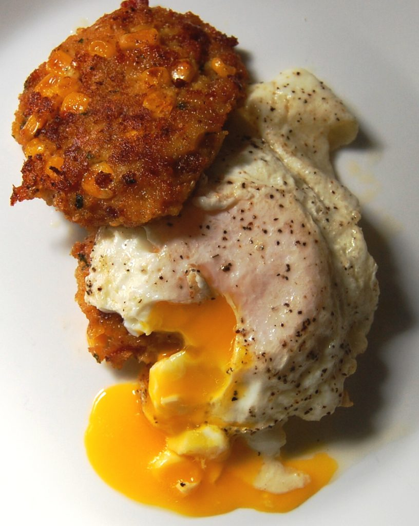 cornbread cheddar bacon cakes with fried eggs