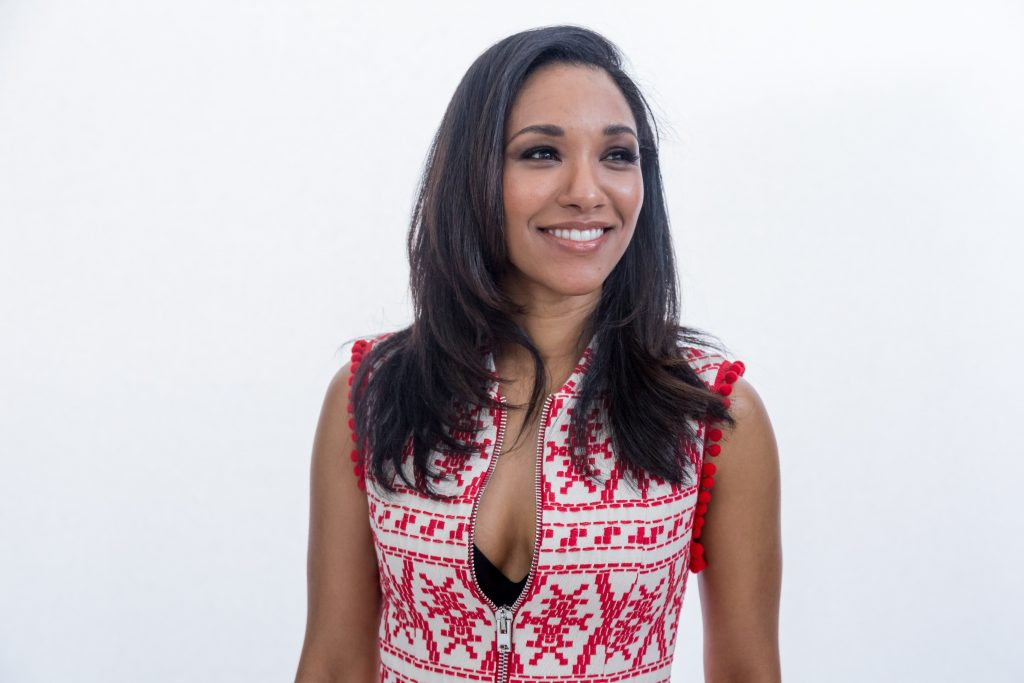 Candice Patton in a low cut red shirt