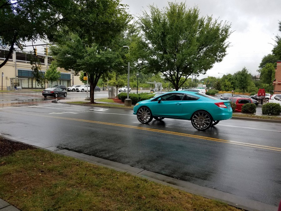 awesome rims on a teal car awesome rims on a teal car