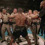 z7iue4q3tpw61 150x150 Las Vegas police facing Mike Tyson after he'd just bitten Holyfield's ear off 1996
